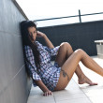 Beautiful young lady posing in garden — Stock Photo #7277087