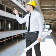 Architect on construction site - Stock Photo