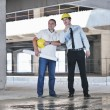 Team of architects on construciton site - Stock Photo