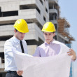 Team of architects on construciton site — Stock Photo #7302864