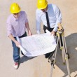 Team of architects on construciton site — Stock Photo #7303310