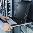 Young it engineer in datacenter server room — Stock Photo #7331447