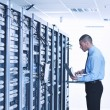 young it engeneer in datacenter server room — Stock Photo #7331814