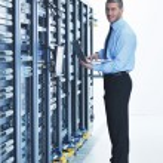 Young it engeneer in datacenter server room — Stock Photo #7332013