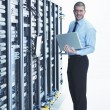 young it engeneer in datacenter server room — Stock Photo #7332057
