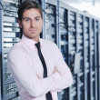Young it engeneer in datacenter server room — Stock Photo #7332493