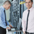 It engineers in network server room — Stock Photo #7333009