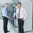 It engineers in network server room — Stock Photo