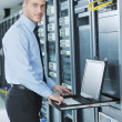 Young it engeneer in datacenter server room — Stock Photo #7333075