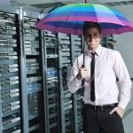 Young it engeneer in datacenter server room — Stock Photo #7333362