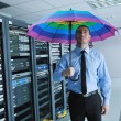 Young it engeneer in datacenter server room — Stock Photo #7333521