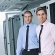 It engineers in network server room — Stock Photo #7333912