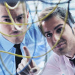 It engineers in network server room — Stock Photo #7334516