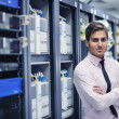 Young it engeneer in datacenter server room — Stock Photo #7334758