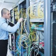 Businessman with laptop in network server room — Stock Photo #7336747