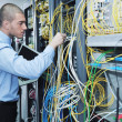 Businessman with laptop in network server room — Stock Photo #7336866