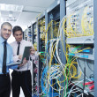 Royalty-Free Stock Photo: It engineers in network server room