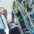 It engineers in network server room — Stock Photo #7337938