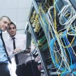 It engineers in network server room — Stock Photo #7338033