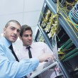 It engineers in network server room — Stock Photo #7338102