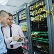 It engineers in network server room - Stock Photo