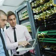 It engineers in network server room — Stock Photo #7338329