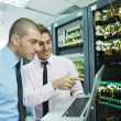 It engineers in network server room — Stock Photo #7338581