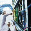 It engineers in network server room — Stock Photo #7338701