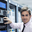 Young it engineer in datacenter server room — Stock Photo #7339889