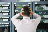 Young it engeneer in datacenter server room — Stock Photo