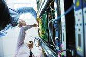 It engineers in network server room — Stock Photo