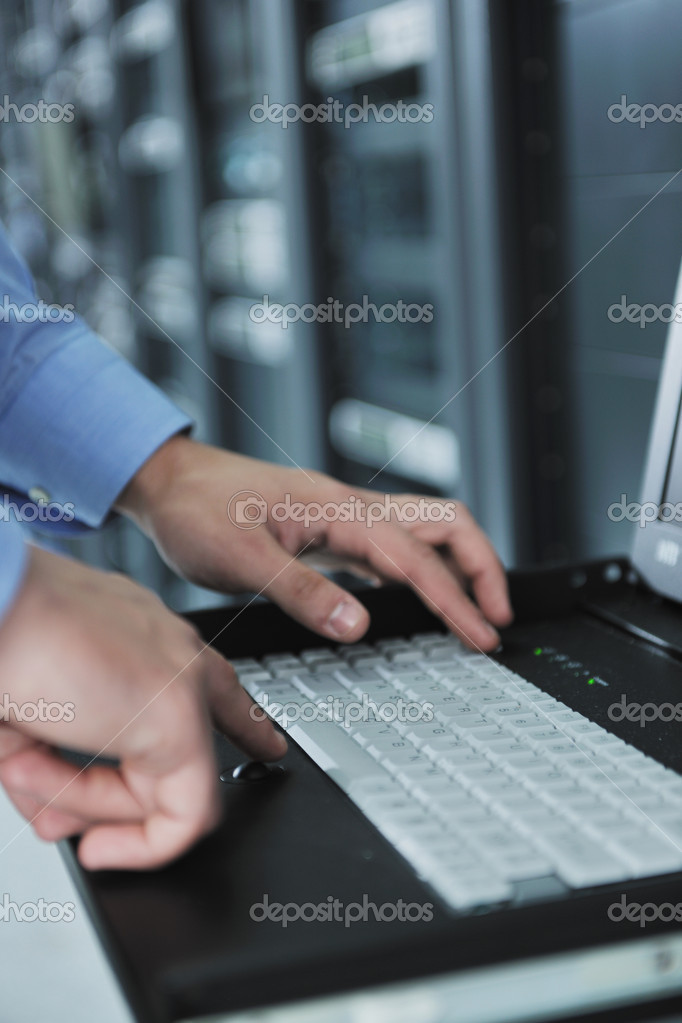 Young handsome business man  engineer in datacenter server room  Stock Photo #7333194