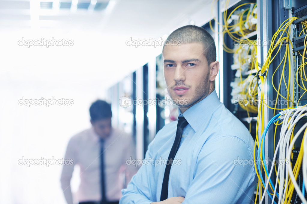 Group of young business it engineer in network server room solving problems and give help and support — Stock Photo #7335868