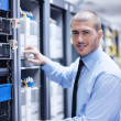 Young it engineer in datacenter server room — Stock Photo #7340158