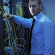 Royalty-Free Stock Photo: Young it engineer in datacenter server room