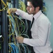 Young it engineer in datacenter server room — Stock Photo #7340353
