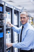 Young it engineer in datacenter server room — Stock Photo