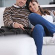 Relaxed young couple watching tv at home — Stock Photo #7399963