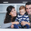Stock Photo: Happy young family have fun at home