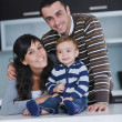 Happy young family have fun at home — Stock Photo #7405984
