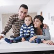 Happy young family have fun  at home — Stok fotoğraf