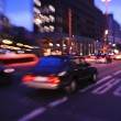 City night with cars motion blurred light in busy street — Stock Photo