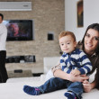 Happy young family have fun  at home — Stock fotografie