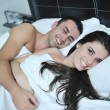 Young couple have good time in their bedroom — Stock Photo