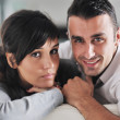 Relaxed young couple watching tv at home — Stockfoto