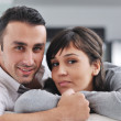 Relaxed young couple watching tv at home — Stock Photo #7592257