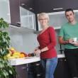 Stock Photo: Young couple have fun in modern kitchen
