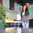 Young couple have fun in modern kitchen — Foto de Stock