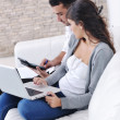 Joyful couple relax and work on laptop computer at modern home — Stock Photo