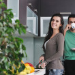 Young couple have fun in modern kitchen — Foto Stock
